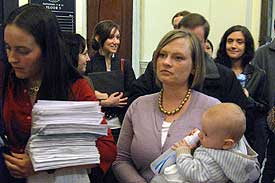 Elizabeth Saunders and Erin Boles, with son Thomas, deliver BPA petitions to Gov. Deval Patrick