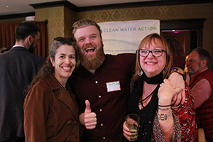 Kristine Acevedo (left) and Clean Water Action Advisory Board Member Jeremy Shenk (middle) smile with NE Director Cindy Luppi.