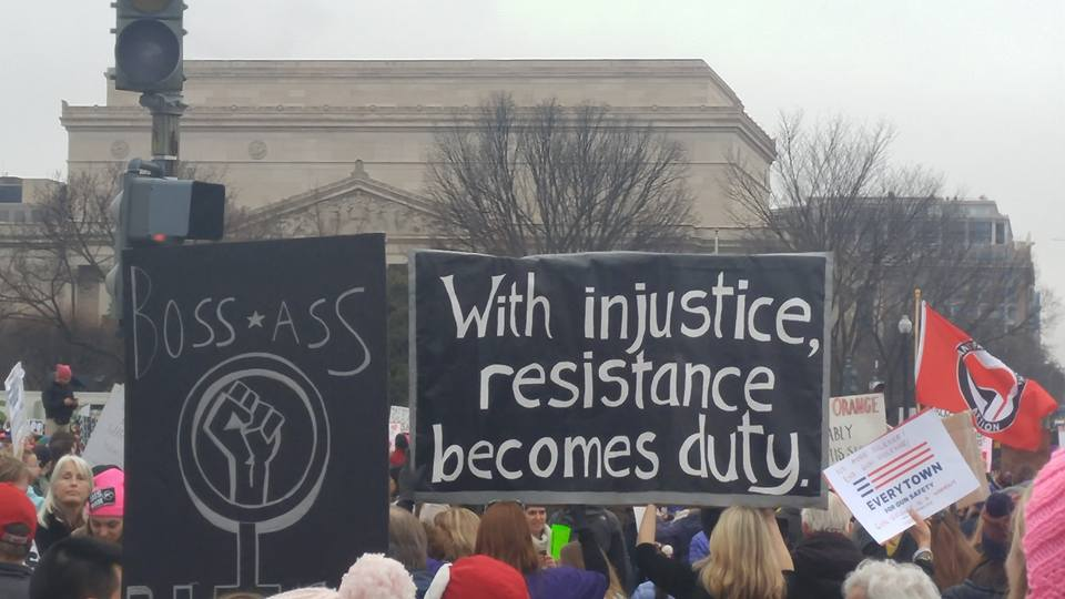 Resist Injustice sign at Women's March - Michael Kelly