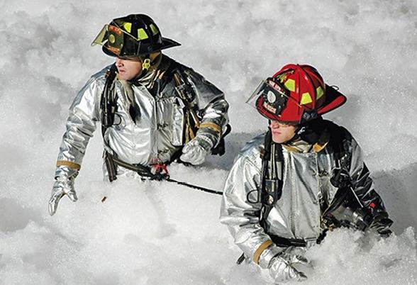 Firefighters surrounded by PFAS firefighting foam