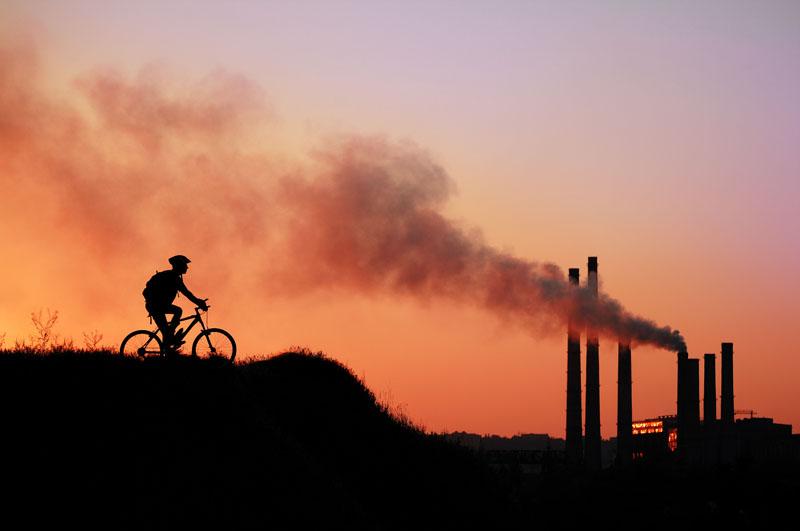 Sunset, powerplant, cyclist. Photo credit: Kalmatsuy / Shutterstock