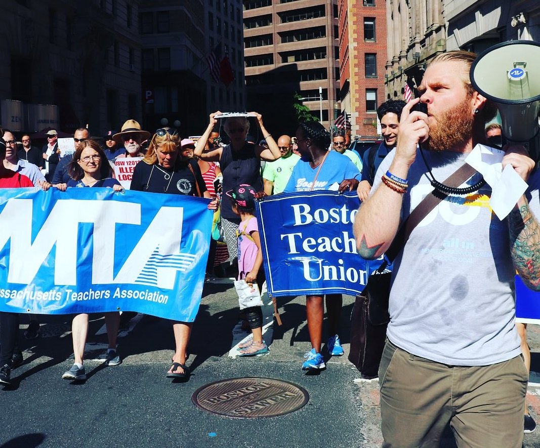 Jeremy Shenk (with megaphone) at a march