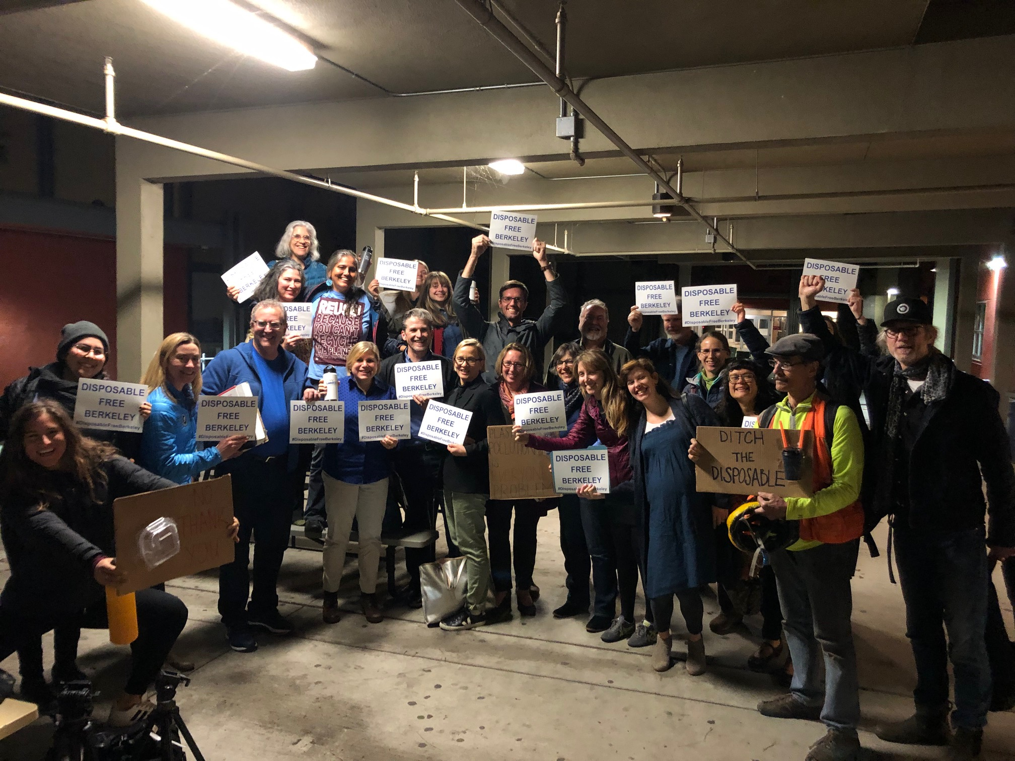 Community advocates, including ReThink Disposable team members, celebrate the passage of the Berkeley ordinance