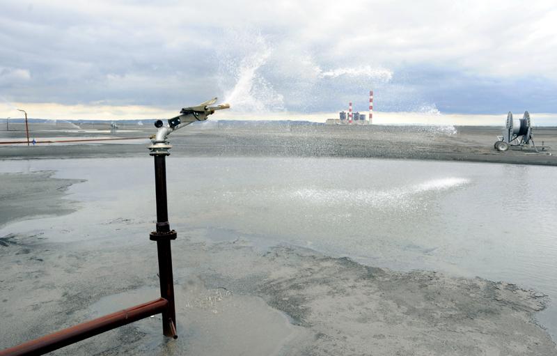 Sprinkler at a coal ash disposal site. Photo credit: bibiphoto / Shutterstock
