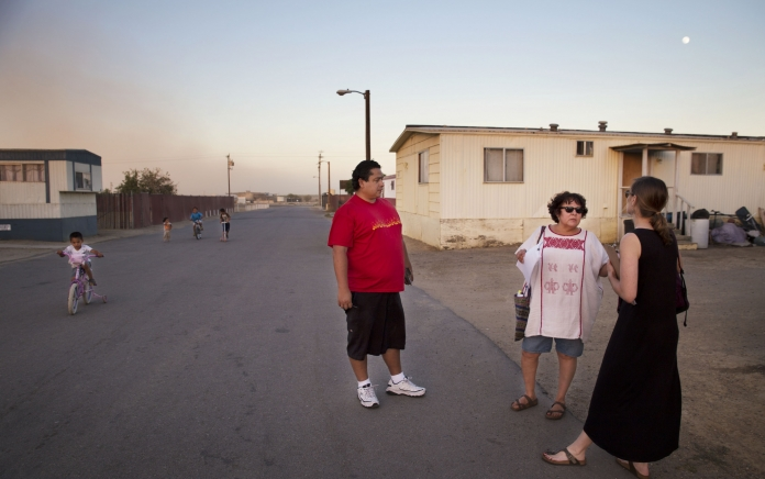 Rosanna Esparza (center) with residents in Kern County