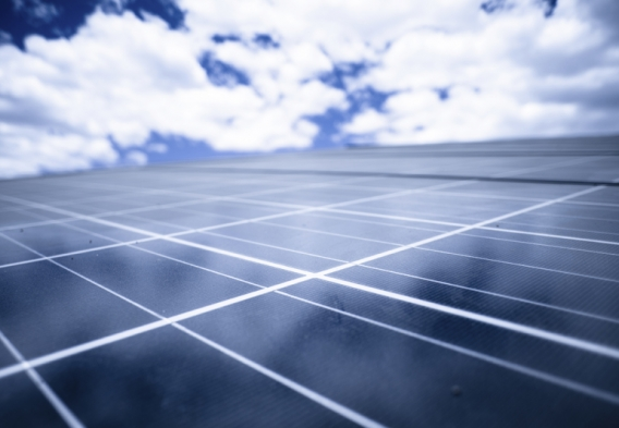 Solar panels, blue sky. Photo credit: epicurean / iStock