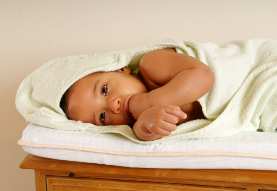 A baby in a blanket / photo: istock lostinbids