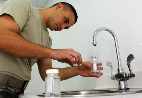 a man conducting water testing