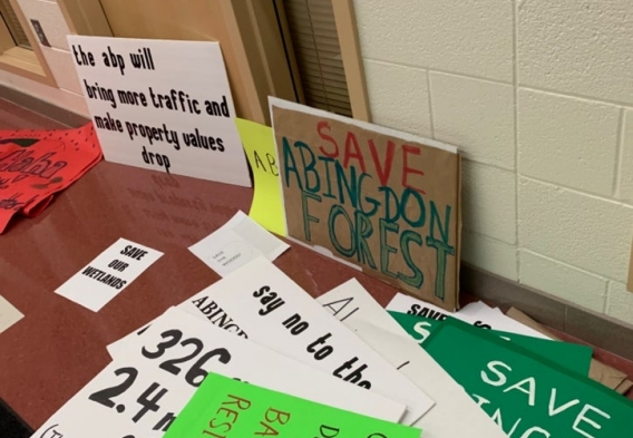 Photo of protest signs at public hearing. Courtesy of Patch.com