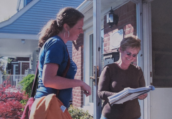Clean Water Action field canvasser speaking to a member on her doorstep