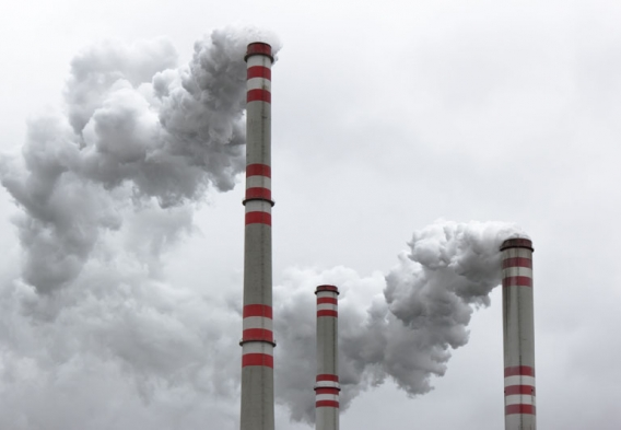 Three power plant smoke stacks. Photo credit: martin33 / Shutterstock