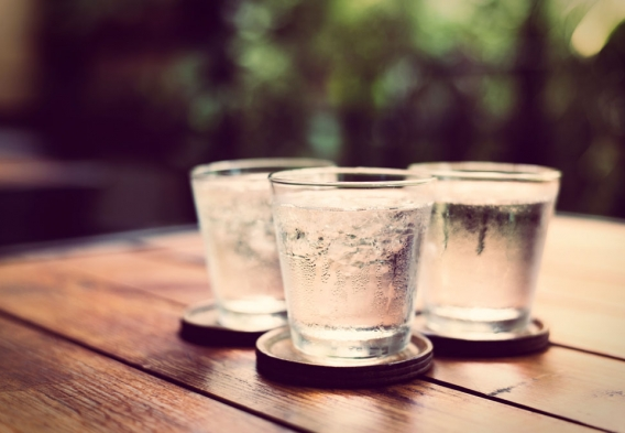 Three glasses of water on a table. Photo credit:  bunyarit / Shutterstock
